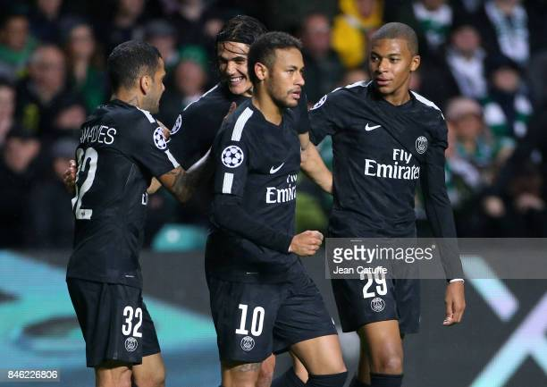 Neymar Jr of PSG celebrates his goal with Dani Alves aka Daniel Alves Edinson Cavani Kylian Mbappe during the UEFA Champions League match between...