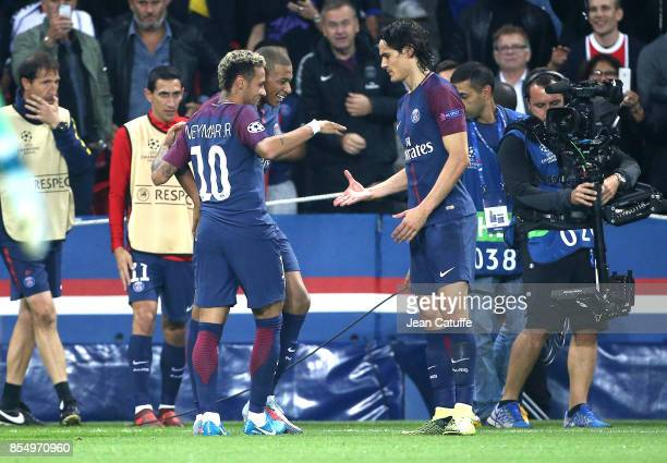 Neymar Jr of PSG celebrates his goal with Kylian Mbappe and Edinson Cavani while Angel Di Maria looks on during the UEFA Champions League group B...