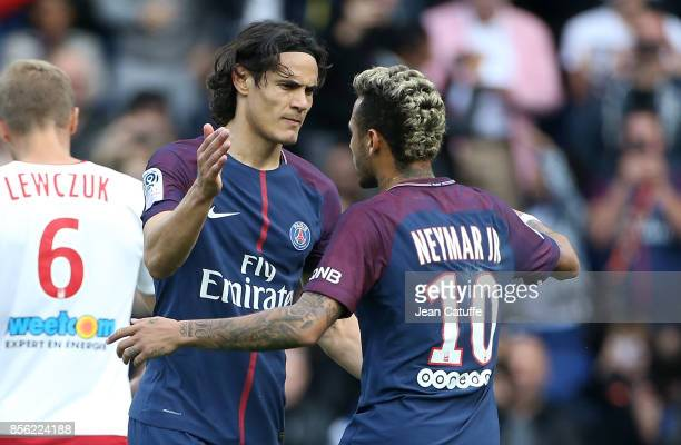 Neymar Jr of PSG celebrates his second goal with Edinson Cavani during the French Ligue 1 match between Paris SaintGermain and FC Girondins de...