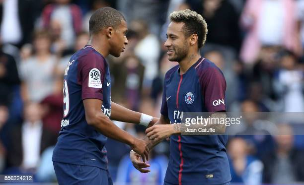 Neymar Jr of PSG celebrates his second goal with Kylian Mbappe during the French Ligue 1 match between Paris SaintGermain and FC Girondins de...