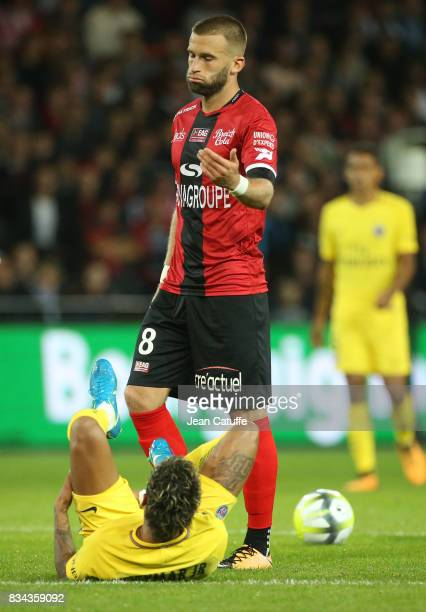 Neymar Jr of PSG lying down and Lucas Deaux of Guingamp during the French Ligue 1 match between En Avant Guingamp and Paris Saint Germain at Stade de...