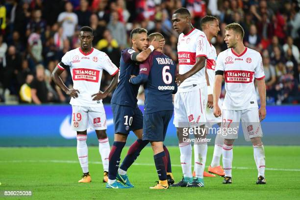 Neymar JR of PSG prevents Marco Verratti of PSG approaching the referee after the latter has received a red card during the Ligue 1 match between...