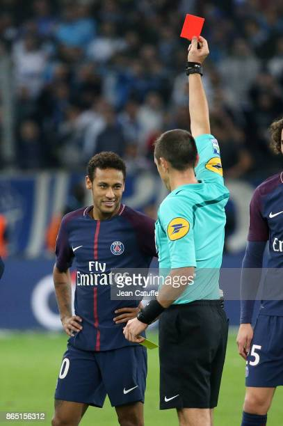 Neymar Jr of PSG receives a red card from referee Ruddy Buquet during the French Ligue 1 match between Olympique de Marseille and Paris Saint Germain...