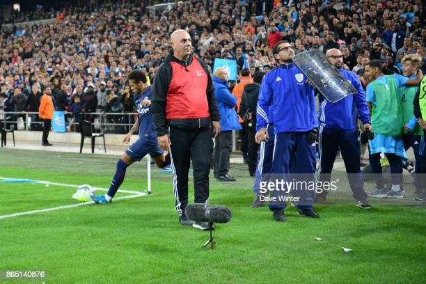 Neymar JR of PSG requires protection from police and stewards as Marseille fans throw objects during the Ligue 1 match between Olympique Marseille...