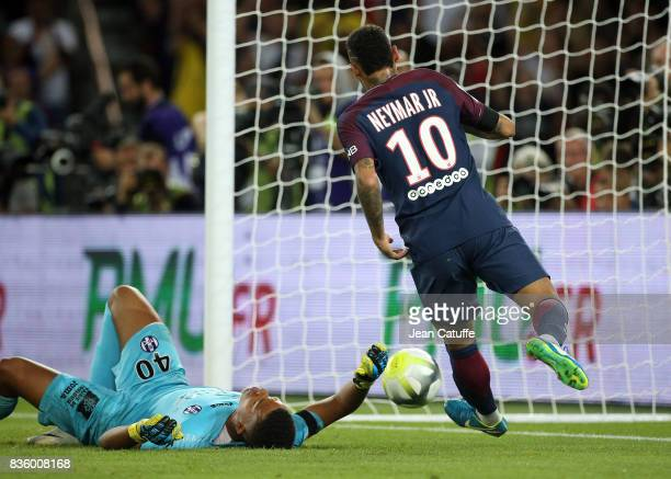 Neymar Jr of PSG scores his first goal while goalkeeper of Toulouse Alban Lafont lies down during the French Ligue 1 match between Paris Saint...