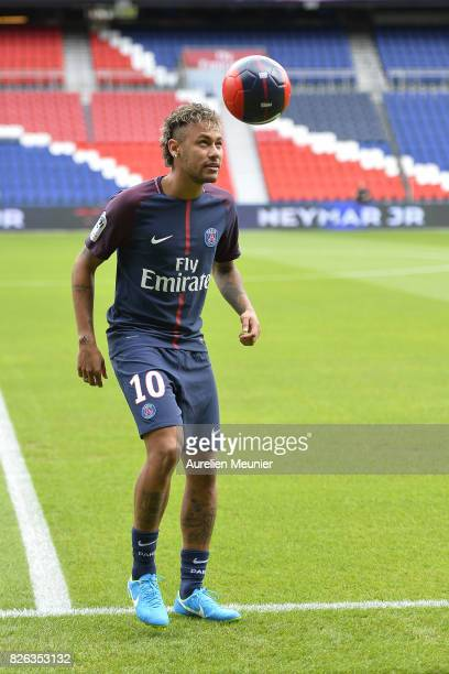 Neymar juggles after he posed with his new jersey after a press conference with Paris SaintGermain President Nasser AlKhelaifi on August 4 2017 in...