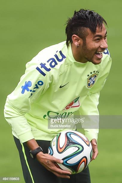 Neymar juggles with a ball during a training session of the Brazilian national football team at the squad's Granja Comary training complex in...