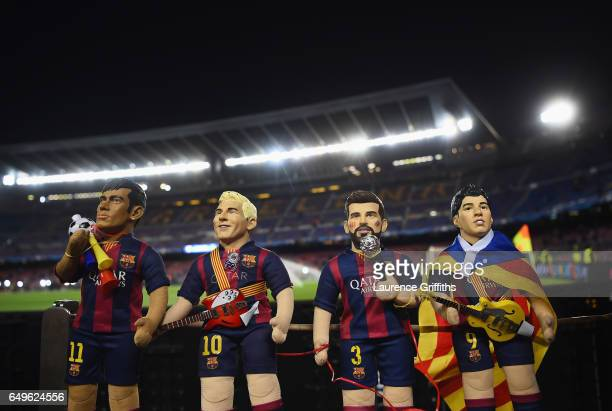 Neymar Lionel Messi Gerard Pique and Luis Suarez dolls are seen prior to the UEFA Champions League Round of 16 second leg match between FC Barcelona...