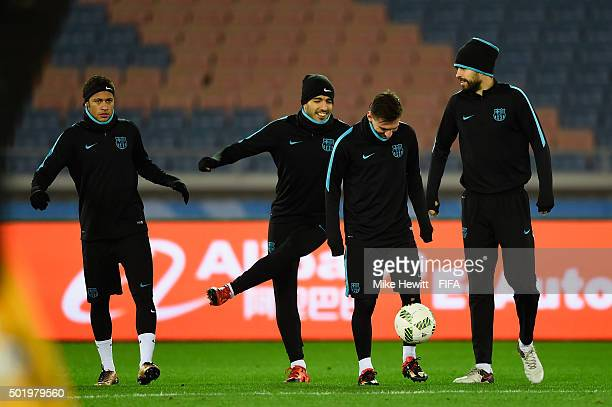 Neymar Luis Suarez Lionel Messi and Gerard Pique of Barcelona take part in a Barcelona training session ahead of the FIFA Club World Cup Japan 2015...