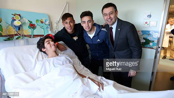 Neymar Munir El Haddoudi and Club President Josep Maria Bartomeu of FC Barcelona visits sick children as part of the 'A Dream for a Gift' Campaign on...