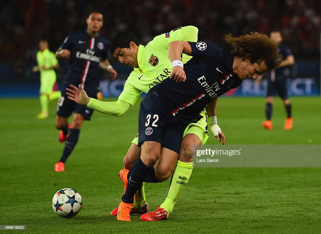 Neymar of Barcelona and David Luiz of PSG battle for the ball during the UEFA Champions League Quarter Final First Leg match between Paris Saint-Germain and FC Barcelona at Parc des Princes on April 15, 2015 in Paris, France.