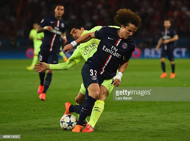 Neymar of Barcelona and David Luiz of PSG battle for the ball during the UEFA Champions League Quarter Final First Leg match between Paris...