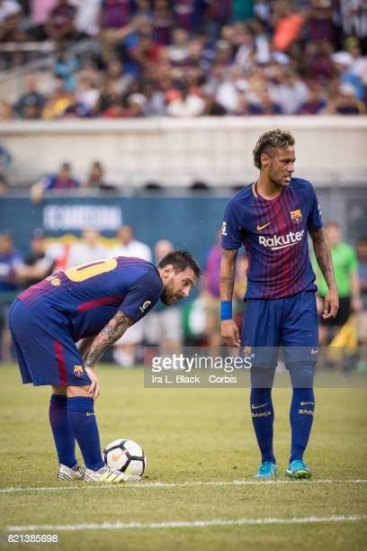 Neymar of Barcelona and Lionel Messi of Barcelona eye up the penalty kick shot during the International Champions Cup match between FC Barcelona and...