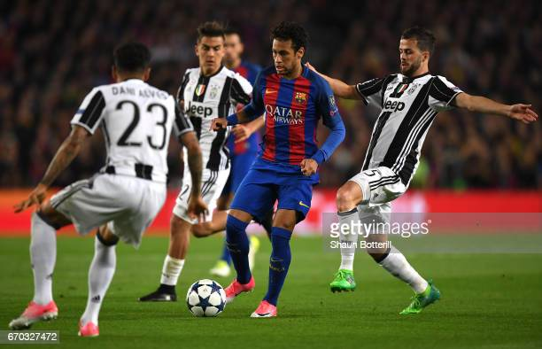 Neymar of Barcelona attempts to get away from Miralem Pjanic of Juventus during the UEFA Champions League Quarter Final second leg match between FC...