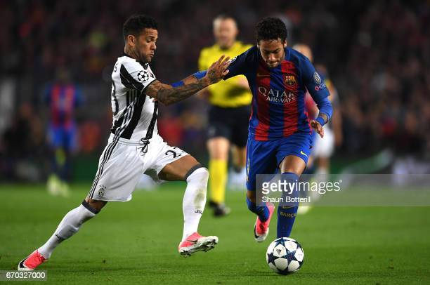 Neymar of Barcelona attempts to take the ball past Dani Alves of Juventus during the UEFA Champions League Quarter Final second leg match between FC...