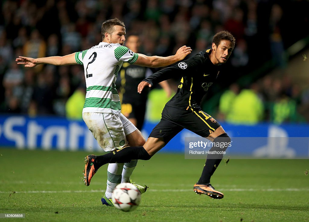 Neymar of Barcelona beats Adam Matthews of Celtic during the UEFA Champions League Group H match between Celtic and FC Barcelona at Celtic Park Stadium on October 1, 2013 in Glasgow, Scotland.