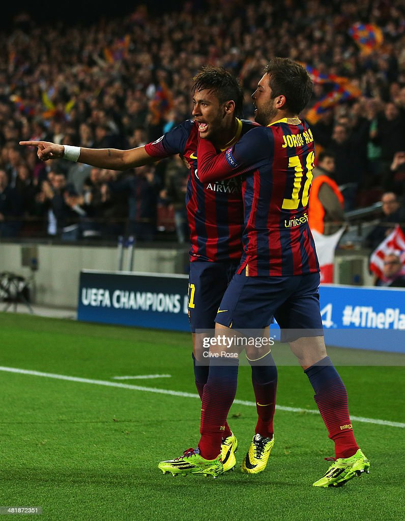 Neymar (L) of Barcelona celebrates his goal with Jordi Alba of Barcelona during the UEFA Champions League Quarter Final first leg match between FC Barcelona and Club Atletico de Madrid at Camp Nou on April 1, 2014 in Barcelona, Spain.
