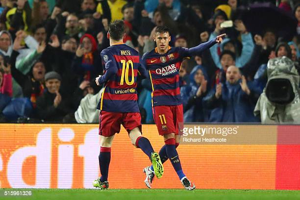Neymar of Barcelona celebrates scoring his team's first goal with his team mate Lionel Messi during the UEFA Champions League round of 16 second Leg...