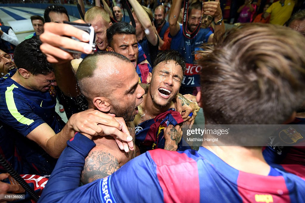 Neymar of Barcelona celebrates scoring his team's third goal with team mates during the UEFA Champions League Final between Juventus and FC Barcelona at Olympiastadion on June 6, 2015 in Berlin, Germany.
