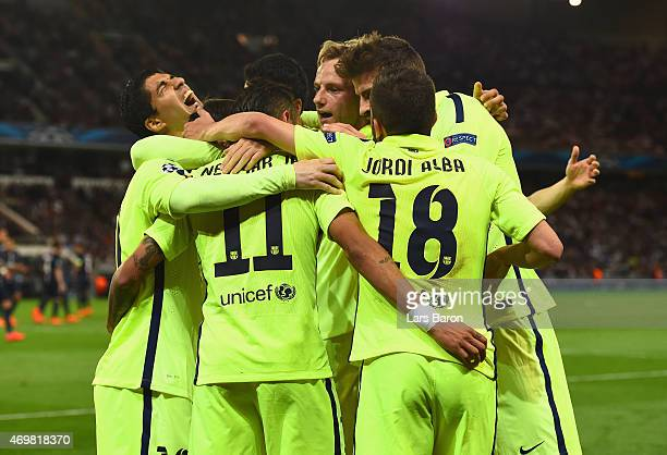Neymar of Barcelona celebrates scoring the opening goal with team mates during the UEFA Champions League Quarter Final First Leg match between Paris...