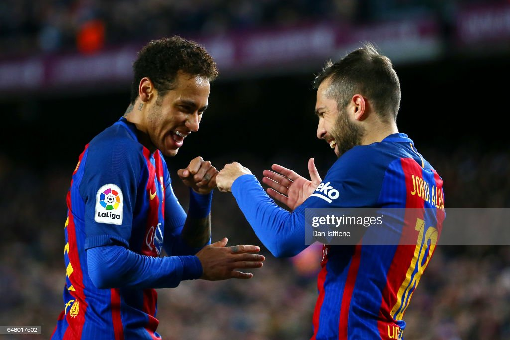 Neymar of Barcelona celebrates with Jordi Alba after scoring their second goal during the La Liga match between FC Barcelona and RC Celta de Vigo at the Camp Nou on March 4, 2017 in Barcelona, Spain.