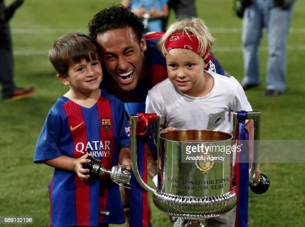 Neymar of Barcelona celebrates with the trophy after the Copa Del Rey Final between FC Barcelona and Deportivo Alaves at Vicente Calderon Stadium on...