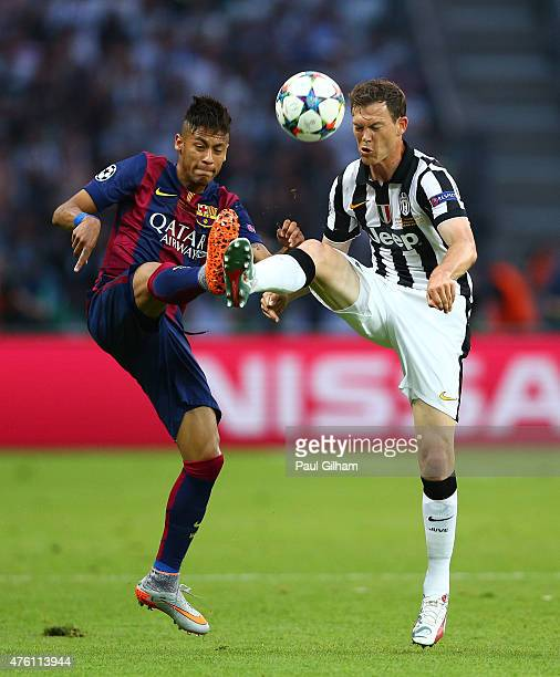 Neymar of Barcelona challenges for the ball with Stephan Lichtsteiner of Juventus during the UEFA Champions League Final between Juventus and FC...