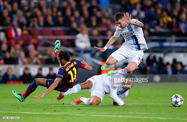 Neymar of Barcelona collides with Joleon Lescott and Aleksandar Kolarov of Manchester City during the UEFA Champions League Round of 16 second leg...