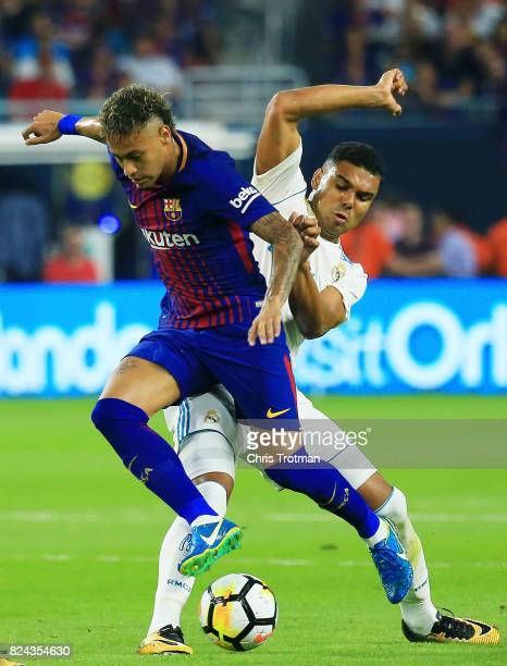 Neymar of Barcelona controls the ball against Casemiro of Real Madrid in the first half during their International Champions Cup 2017 match at Hard...