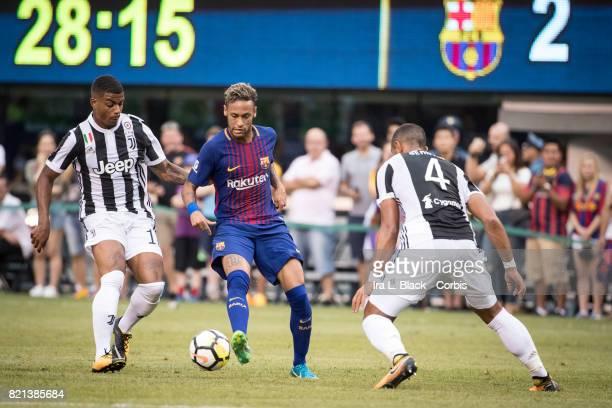 Neymar of Barcelona cuts past Mario Lemina of Juventus and Mehdi Benatia of Juventus during the International Champions Cup match between FC...