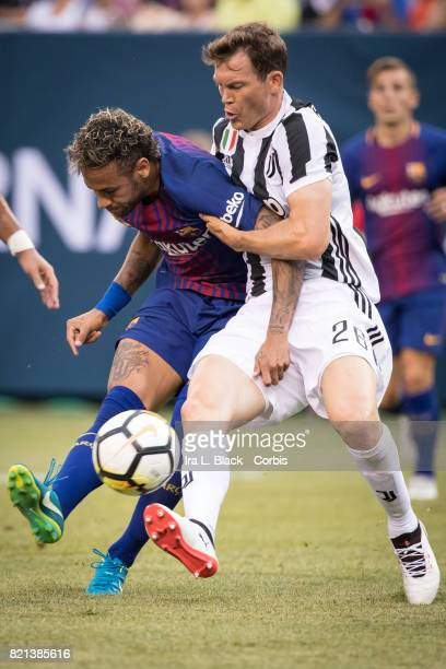 Neymar of Barcelona gets the shot off for a goal against Stephan Lichtsteiner of Juventus during the International Champions Cup match between FC...