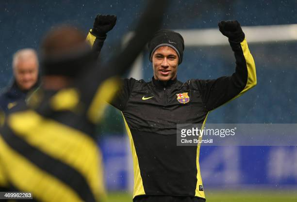 Neymar of Barcelona in good spirits during a training session ahead of their UEFA Champions League Round of 16 match 1st leg against Manchester City...