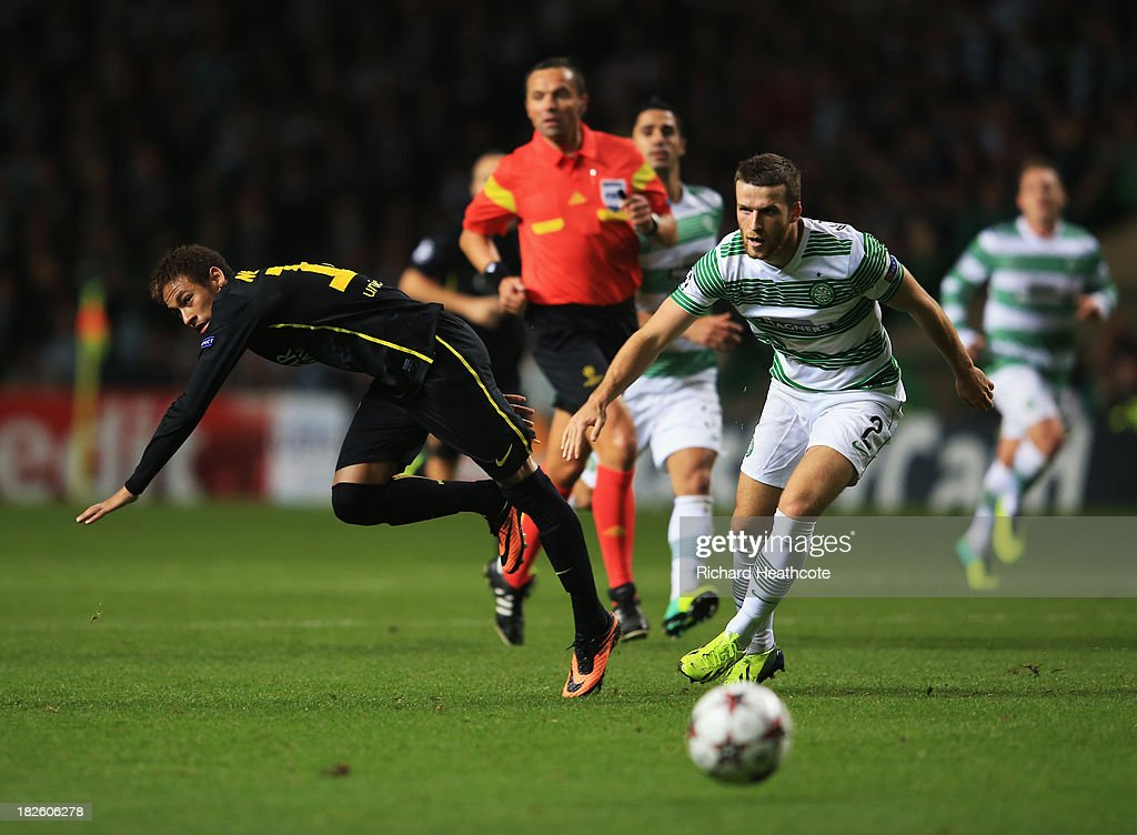 Neymar of Barcelona is challenged by Adam Matthews of Celtic during the UEFA Champions League Group H match between Celtic and FC Barcelona at Celtic Park Stadium on October 1, 2013 in Glasgow, Scotland.
