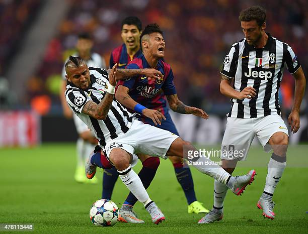 Neymar of Barcelona is challenged by Arturo Vidal and Claudio Marchisio of Juventus during the UEFA Champions League Final between Juventus and FC...