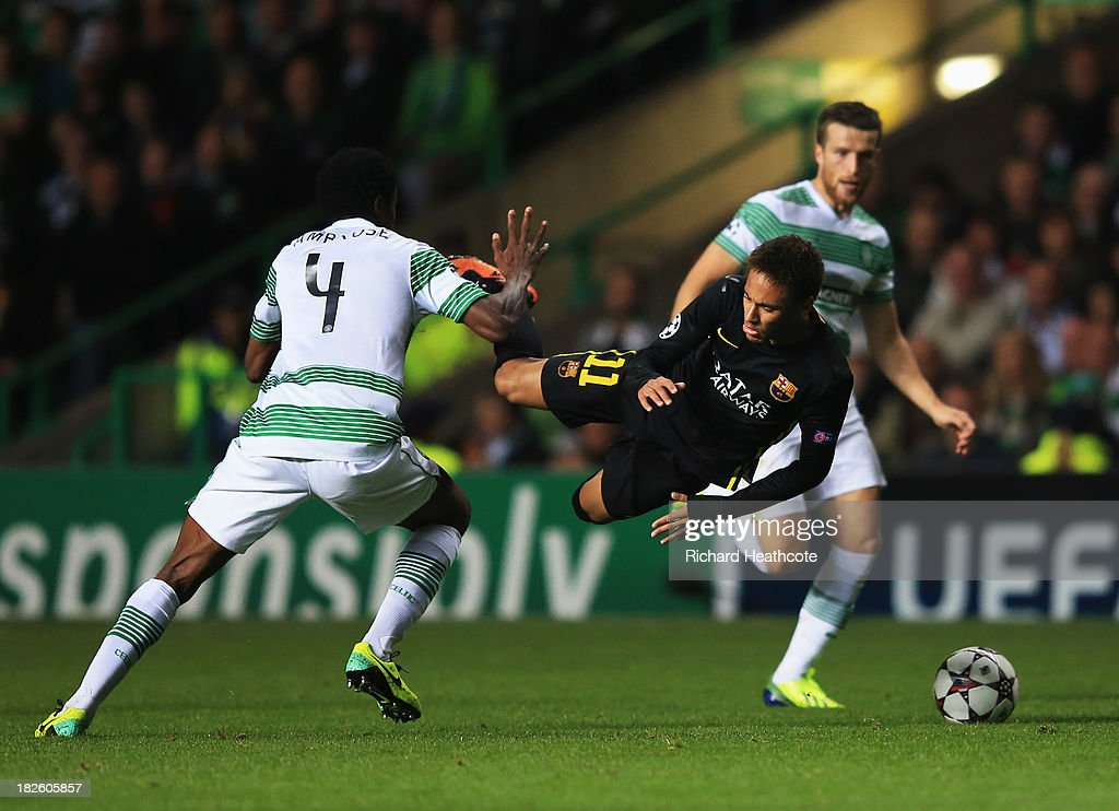 Neymar of Barcelona is challenged by <a gi-track='captionPersonalityLinkClicked' href=/galleries/search?phrase=Efe+Ambrose&family=editorial&specificpeople=4406353 ng-click='$event.stopPropagation()'>Efe Ambrose</a> of Celtic during the UEFA Champions League Group H match between Celtic and FC Barcelona at Celtic Park Stadium on October 1, 2013 in Glasgow, Scotland.