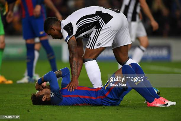 Neymar of Barcelona is consoled by Mario Lemina of Juventus after the UEFA Champions League Quarter Final second leg match between FC Barcelona and...