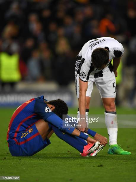 Neymar of Barcelona is consoled by Miralem Pjanic of Juventus after the UEFA Champions League Quarter Final second leg match between FC Barcelona and...