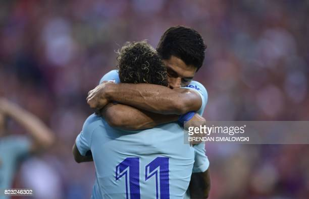 Neymar of Barcelona is embraced after scoring the first goal in their International Champions Cup football match against Manchester United on July 26...