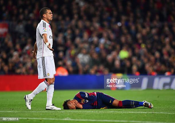 Neymar of Barcelona is injured as Pepe of Real Madrid CF appeals during the La Liga match between FC Barcelona and Real Madrid CF at Camp Nou on...