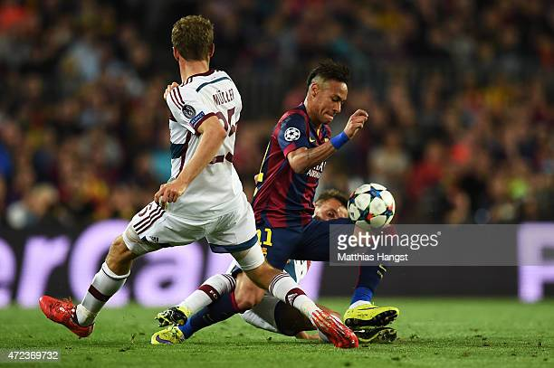 Neymar of Barcelona is tackled by Rafinha of Bayern Muenchen during the UEFA Champions League Semi Final first leg match between FC Barcelona and FC...