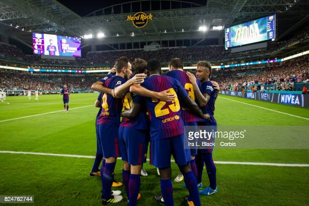 Neymar of Barcelona joins teammates to celebrate goal by Gerard Pique of Barcelona during the International Champions Cup El Clásico match between FC...
