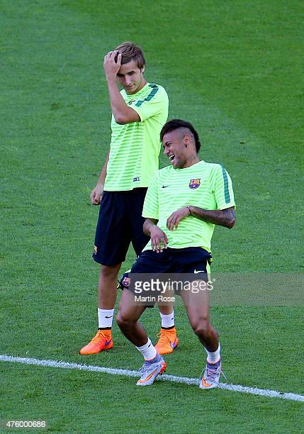 Neymar of Barcelona laughs with Sergi Samper during an FC Barcelona training session on the eve of the UEFA Champions League Final match against...