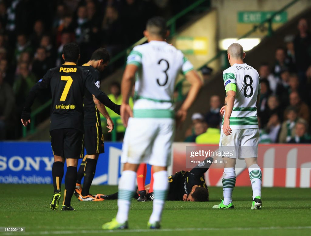 Neymar of Barcelona lays on the ground after a challenge by Scott Brown of Celtic (8) during the UEFA Champions League Group H match between Celtic and FC Barcelona at Celtic Park Stadium on October 1, 2013 in Glasgow, Scotland.