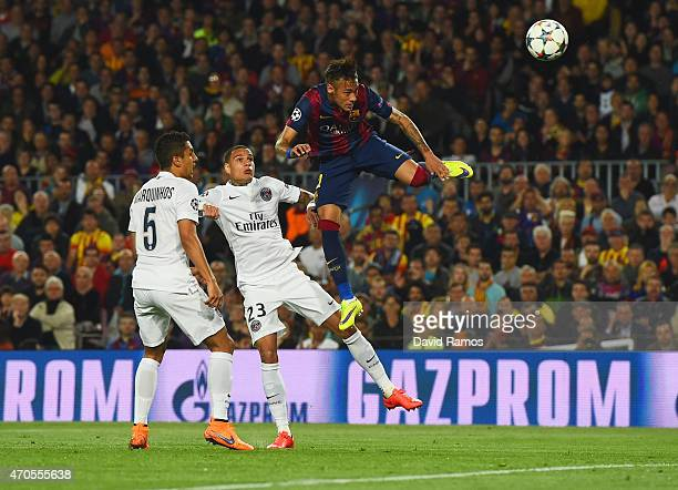 Neymar of Barcelona outjumps Marquinhos and Gregory van der Wiel of PSG during the UEFA Champions League Quarter Final second leg match between FC...