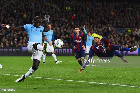 Neymar of Barcelona performs a scissor kick as he is closed down by Bacary Sagna of Manchester City during the UEFA Champions League Round of 16...