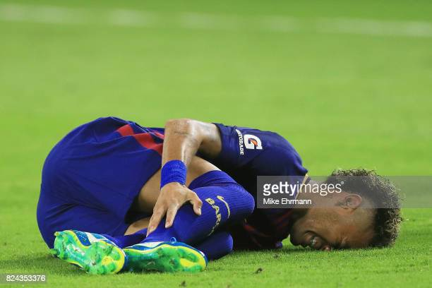 Neymar of Barcelona reacts to an injury in the second half against the Real Madrid during their International Champions Cup 2017 match at Hard Rock...