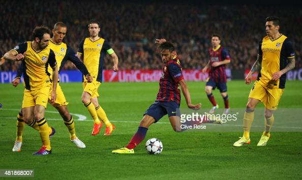 Neymar of Barcelona shoots at goal during the UEFA Champions League Quarter Final first leg match between FC Barcelona and Club Atletico de Madrid at...