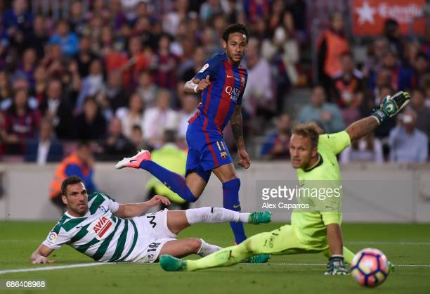 Neymar of Barcelona shoots leading to an own goal scored by David Junca of Eibar during the La Liga match between Barcelona and Eibar at Camp Nou on...
