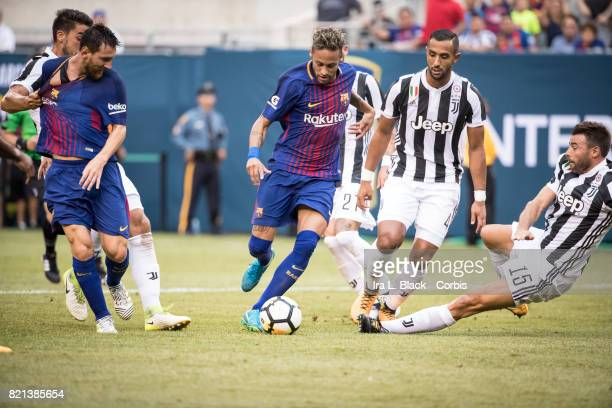 Neymar of Barcelona takes the shot on goal against Mehdi Benatia of Juventus and Andrea Barzagli of Juventus during the International Champions Cup...