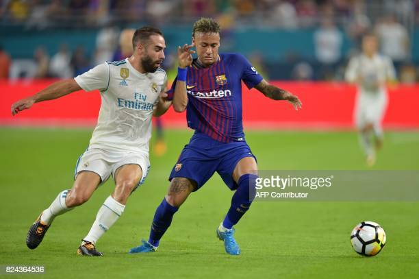 Neymar of Barcelona vies for the ball with Daniel Carvajal of Real Madrid during their International Champions Cup football match at Hard Rock...